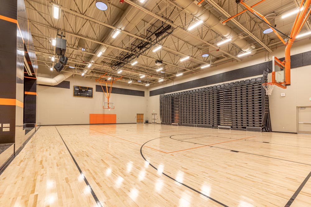 Indoor basketball gym with a lot of lighting.