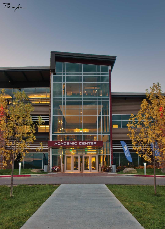 Academic Center entrance lit up at dusk.