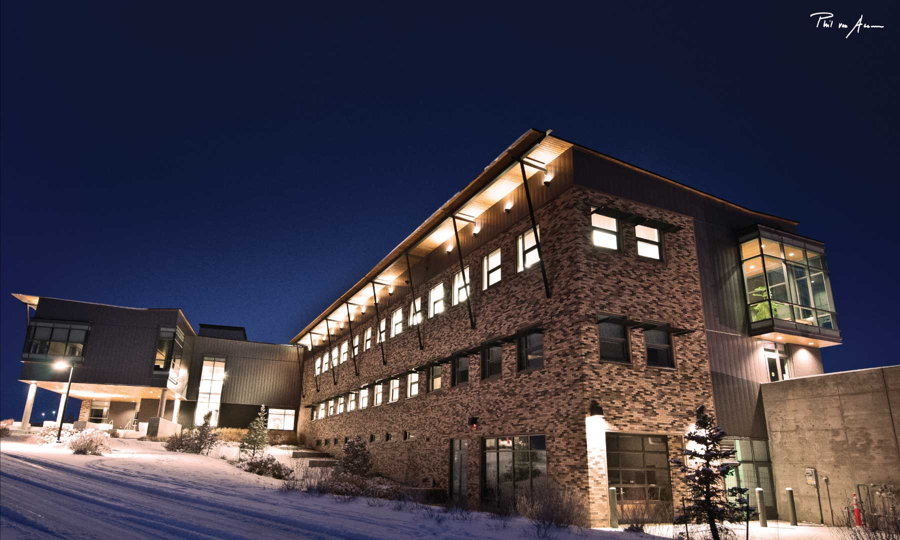 Exterior of CNCC in the winter at night all lit up.