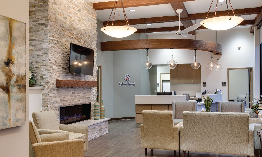 Waiting room inside an ER with glass sconce lighting and large glass chandelier.