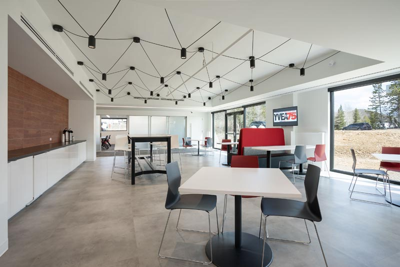 Business break room, lighting with wires showing.
